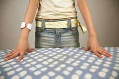 Girl standing next to table Royalty Free Stock Photo