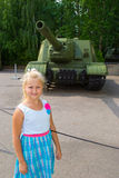 Girl standing next to a tank Royalty Free Stock Photos