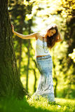 Girl standing next to a tree Stock Image