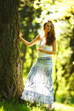Girl standing next to a tree Royalty Free Stock Images