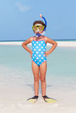 Girl Standing On Beach Wearing Snorkel And Flippers Stock Image