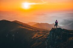 Free Girl Standing On The Top Of The Hill On The Mountains Meadow With Beautiful Colorful Sunset Over Landscape Stock Photo - 177965890