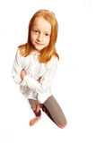 Girl standing on one leg. Young girl standing on one leg royalty free stock image