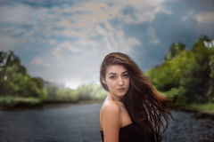 Girl standing outdoors against the sky Royalty Free Stock Image