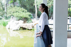 Girl standing outdoors Stock Photo