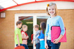 Girl Standing Outside School With Book Bag Royalty Free Stock Photos