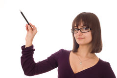 Girl standing with a pen Royalty Free Stock Image
