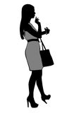 Girl standing  with phone. Girl standing with bag and calling on the phone Royalty Free Stock Photos