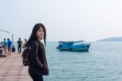 The girl standing on the pier. At Kho Laem Ya national parks Rayong,Thailand Royalty Free Stock Photo