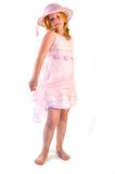 Girl standing in pink dress Royalty Free Stock Images