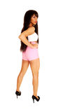 Girl standing in pink shorts. Stock Photo