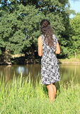 Girl standing by pond Stock Images