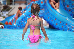Girl standing in pool in aquapark, standing back Stock Photography