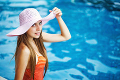 Girl standing in a pool Royalty Free Stock Image