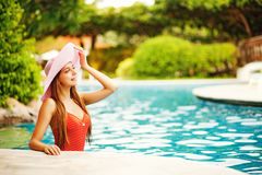 Girl standing in a pool Stock Photo