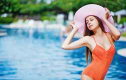 Girl standing by a poolside Stock Photography