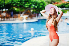Girl standing by a poolside Royalty Free Stock Images