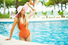 Girl standing by a poolside Stock Photos