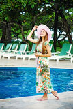Girl standing by poolside Stock Photography
