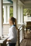 Girl standing on porch. stock photos