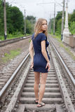 Girl  standing on the rails. Shooting outdoors Stock Image