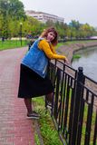 Girl standing on the river embankment royalty free stock photo