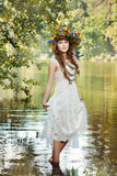 Girl standing in the river. Royalty Free Stock Image