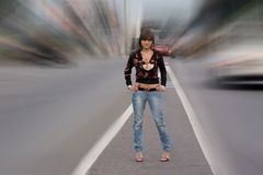 Girl standing on the road. royalty free stock photo