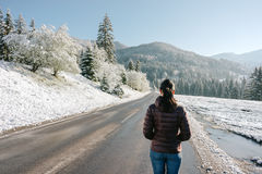 The girl is standing on the road royalty free stock photos