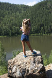 Girl standing on a rock and enjoying river  view Royalty Free Stock Images