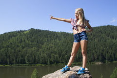 Girl standing on a rock and enjoying river  view Stock Photography