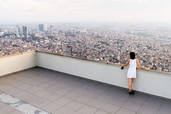 Girl standing on the roof and looking at foggy Istanbul Stock Photography