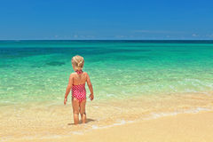 Girl standing on the sand beach Royalty Free Stock Photography