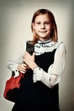 Girl standing with school bag retro style Royalty Free Stock Photo