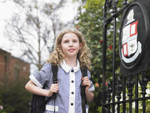 Girl Standing By School Gate Royalty Free Stock Image