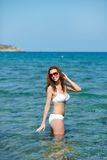 Girl standing in sea Royalty Free Stock Image