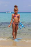 Girl standing in the sea Stock Photography