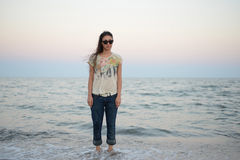 Girl standing in the sea Stock Images