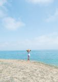 Girl standing on the sea coast Royalty Free Stock Image