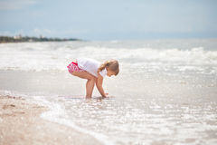 The girl is standing by the sea Stock Photo
