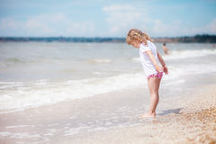 The girl is standing by the sea Royalty Free Stock Image