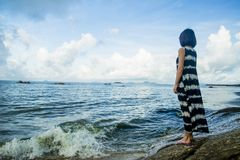 A girl standing by the sea royalty free stock photos