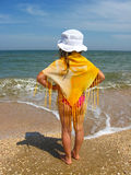 Girl standing at the seacoast Stock Images