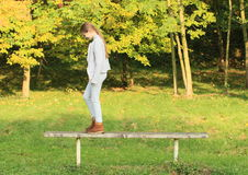 Girl standing on seat Royalty Free Stock Images