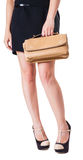 Girl standing with a small handbag Royalty Free Stock Photos
