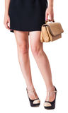 Girl standing with a small handbag Royalty Free Stock Photo