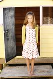 Girl standing and smiling Royalty Free Stock Images