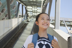 Girl standing and smiling next to the escalator near the subway station Stock Image