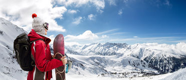 Girl standing with snowboard Stock Photos
