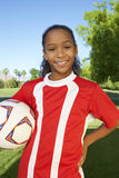 Girl Standing With Soccer Ball Stock Images